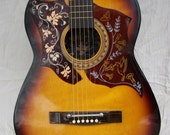 Playable Acoustic Guitar, Hummingbird style with added pickguard and artwork on top, headstock and in soundhole