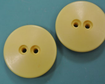 Lot of 4 larger vintage 1960s unused yellow plastic buttons for your sewing/decoration prodjects