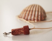 Red craquelle leather wish scroll with bead