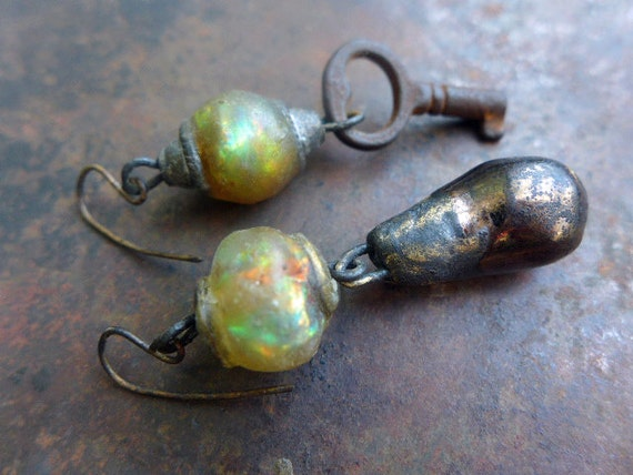 The Unexpected. Rustic asymmetrical art bead earrings. Iridescent art beads, ceramic, key.