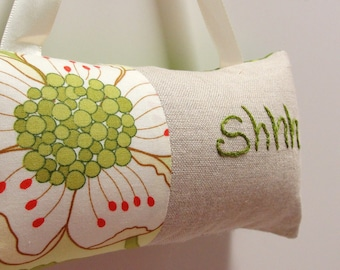 Shhh pillow- doorknob pillow hand embroidered on natural linen with large flower print in olive, red, cream
