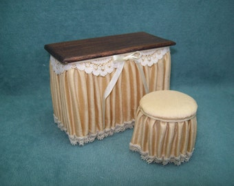 Reduced - One inch scale, Skirted Vanity and Bench in Gold silk with wood stained top.