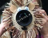Camera lens buddy. Crochet lens critter lion. Photographer helper