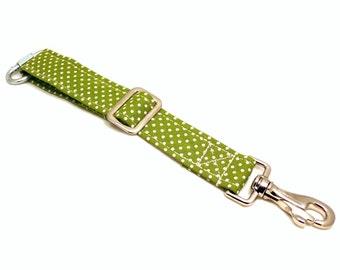 Green and white polka dots dog car safety / seat belt for travelling