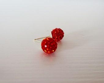 Fiery orange crystal glitter ball disco stud post earrings in silver.  Pave stud earrings.