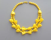 Celluloid Flower Necklace. Early Plastic. Yellow.