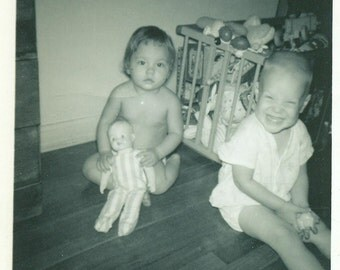 Happy Baby 1960 Sitting on Floor Playing With Doll Toys Black And White Vintage Photo Photograph