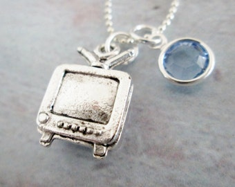 TV Necklace (A044) Three Dimensional Television Charm Necklace. Sterling Silver Plated Charm with Blue Crystal Accent.
