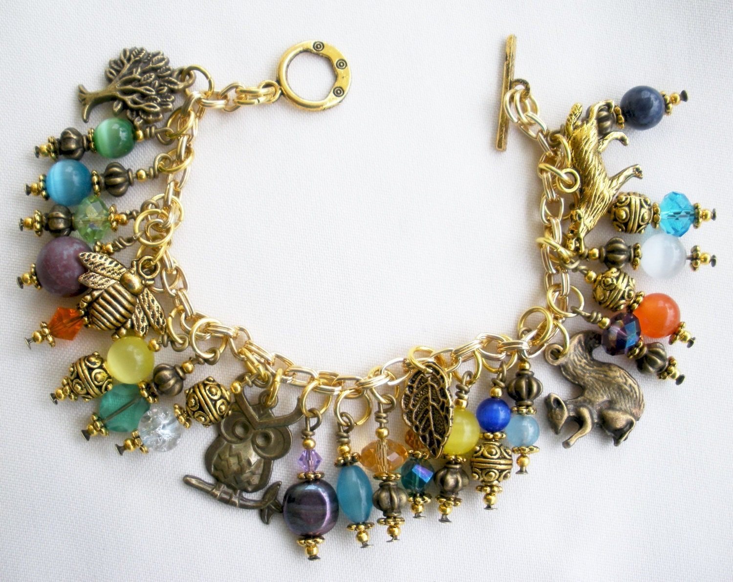 gold charm bracelet owl squirrel wolf bee leaf by topsailwinds