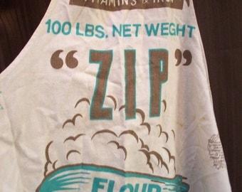 EXCEEDINGLY RARE Zip Flour Sack Apron. Full sized kitchen apron. Zeppelin graphics. Turquoise, Brown. 1930s Depression era Farmhouse.