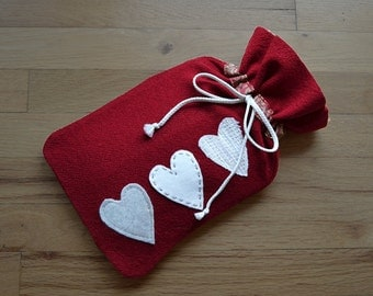 Hot water bottle cover in red felted wool with white hearts