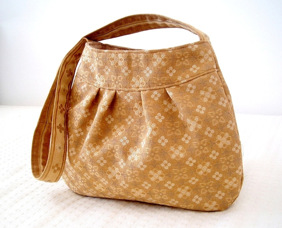 Gold damask shoulder bag in recycled italian upholstery fabric