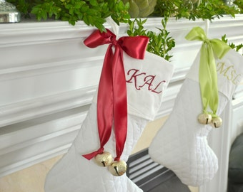 Three personalized White Christmas stocking with bow and bells