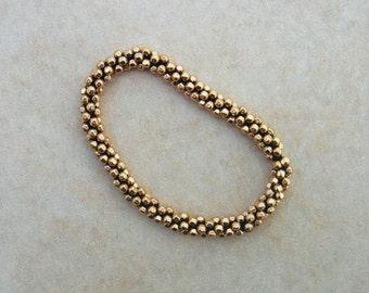 Hand Crocheted Gold  Faceted Bead Bracelet