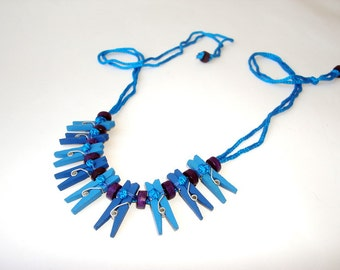 Blue wooden necklace with mini pegs
