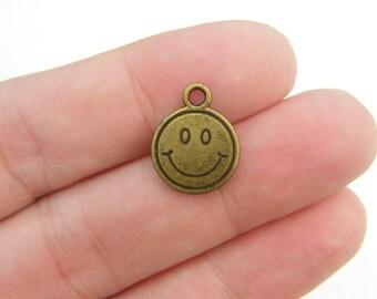 BULK 50 Smiling face charms antique bronze tone BC39