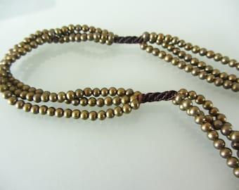 Understatedly elegant bronze bead necklace
