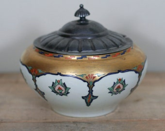vintage porcelain tureen with silver plate lid