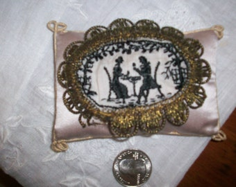 1 Antique applique of black silk embroidery on ivory with metal trim
