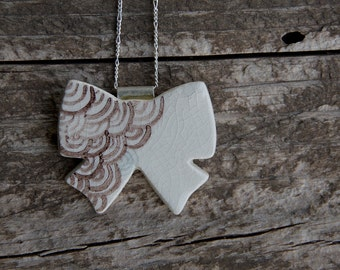 Ceramic bow pendant on sterling silver chain and bail