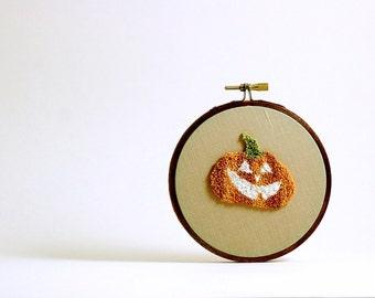 Pumpkin Jack-o-Lantern Glow in the Dark Halloween Decoration. Autumn Fall Home Decor. Orange and Black. Punch Needle Embroidery Hoop Art