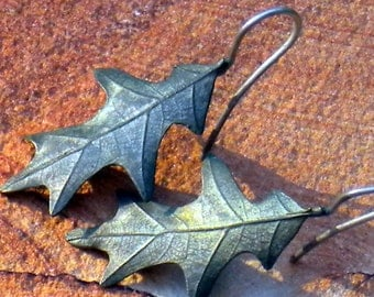 OFF THE BENCH . cast oak leaf . bronze . sterlings silver . earrings
