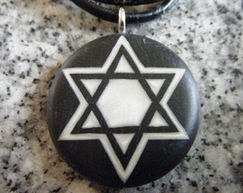 Star of David hand carved on a polymer clay black color background. Pendant comes with a FREE necklace