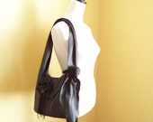 black leather handbag, messenger with detachable flower and fringe, by Tuscada. Made to order..