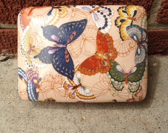 Ceramic card holder with butterfly decoration
