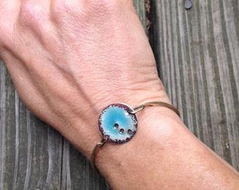 Hammered brass bracelet with gorgeous ocean blue enamel disc.