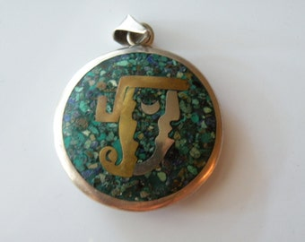 Mexican sterling silver, copper, brass double sided pendant.  Inlaid. Mayan motif.