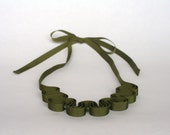green grosgrain necklace stitched with glass beads