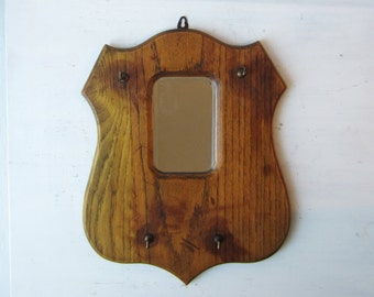 Antique Oak Shield Mirror with Coat Brush Hooks