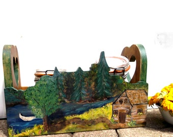 Cabin Caddy - Canadian Folk Artist Julie Johnson offers log cabin on river, with birch canoe