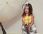 """Pillow dress  """"Bri"""" Camera print fabric with chevron color on top with Fabric Bow Headband."""