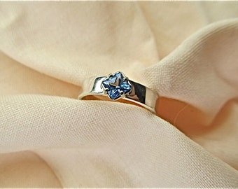 Silver and 14k white gold ring with square paradise blue topaz