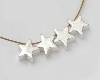 4 of 925 Sterling Silve Little Star Beads 5mm. :th1871