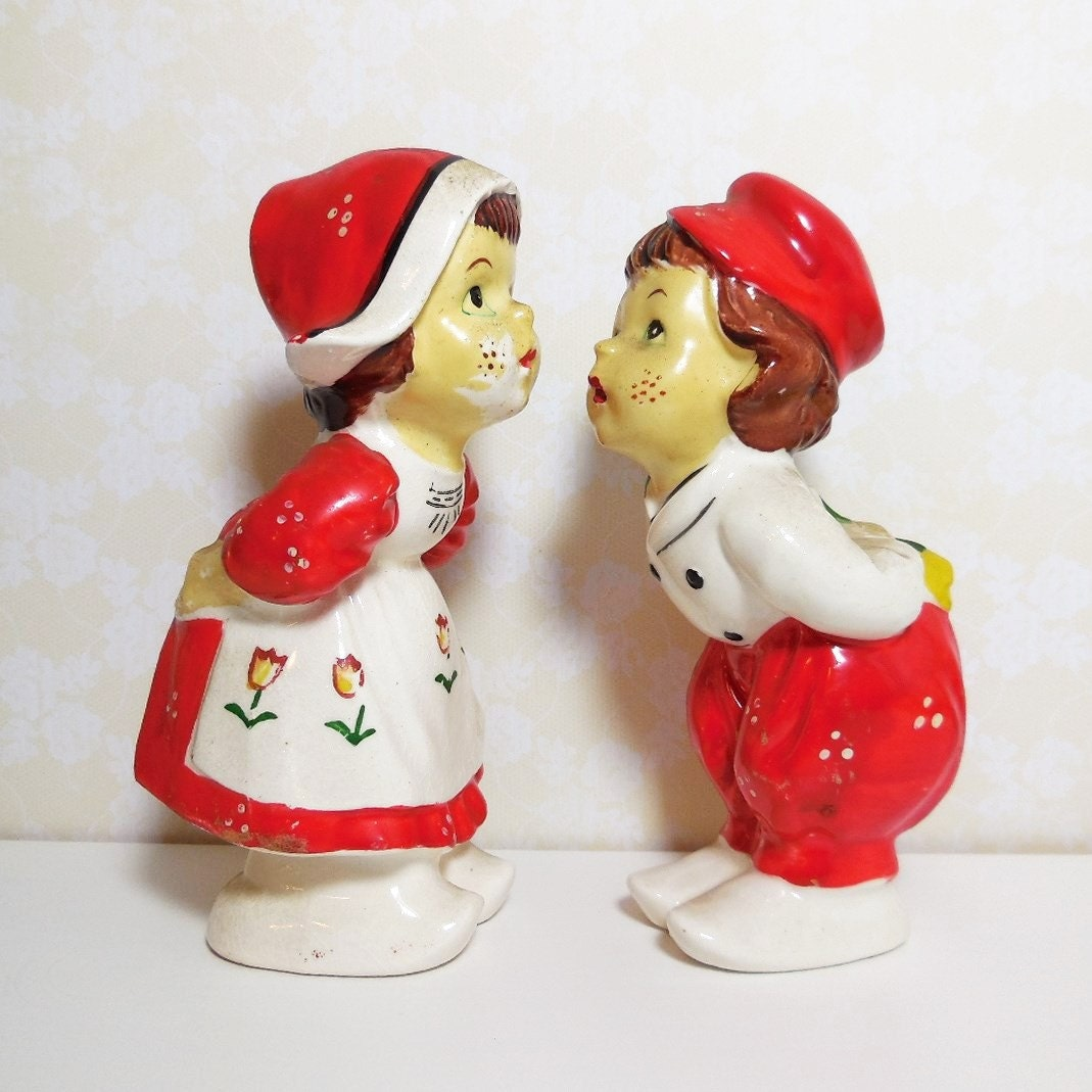 Dutch boy and girl kissing couple salt and pepper shaker set - Salt and pepper shakers hugging ...