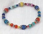 Luminous Miracle Bead Bracelet, 7 1/2 inches (19c) L to XL, Jewel Tone Miracle Beads with Bali Silver Accents and Bead Caps on Stretch Cord