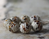 ribbed round lampwork beads - ivory with brown and green specks