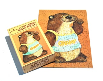 Shirt Tales Double Sided Puzzle Featuring Champ the Otter