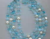 Pretty vintage 4-strand glass bead necklace signed Western Germany - aqua and opalescent robin's-egg-blue