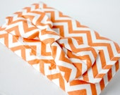 Womans zigzag Pouch purse wallet Chevron print in tangerine orange and white with bow.