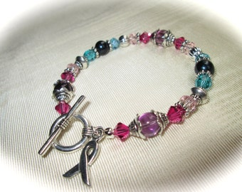 Thyroid Cancer Awareness bracelet with purple pink turquoise and teal beads teal freshwater pearls toggle clasp
