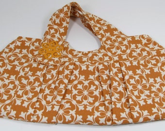 Purse, orange and white pleated