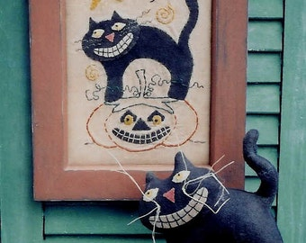 The Country Cupboard Halloween Is Primitive Folk Art Craft Sewing Pattern Black Cat on a Pumpkin and Stitchery Sampler