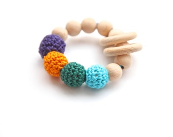 Organic teether. Teething ring toy with crochet wooden beads. Rattle for baby. Teether
