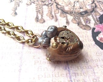 Steampunk Bronze and Silver Heart Necklace - Embedded w/ vintage watch pieces