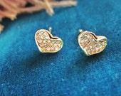 16k Petite gold sparkly heart earrings on .925 sterling silver studs. Pierced.