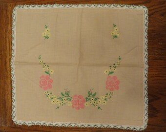 Rectangle linen colored scarf with pink cross stitch roses and yellow coreopsis, cream and green edges.